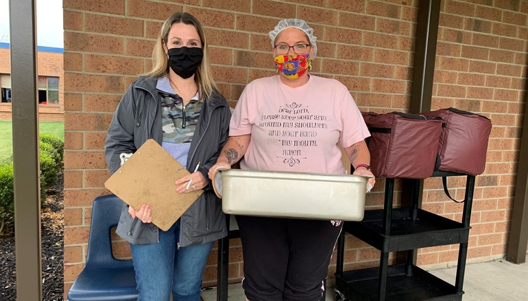 FRC Coordinator, Trish Conley and Taylor Elementary school staff Crystal Teegarden handing out lunches for students who are remaining virtual.